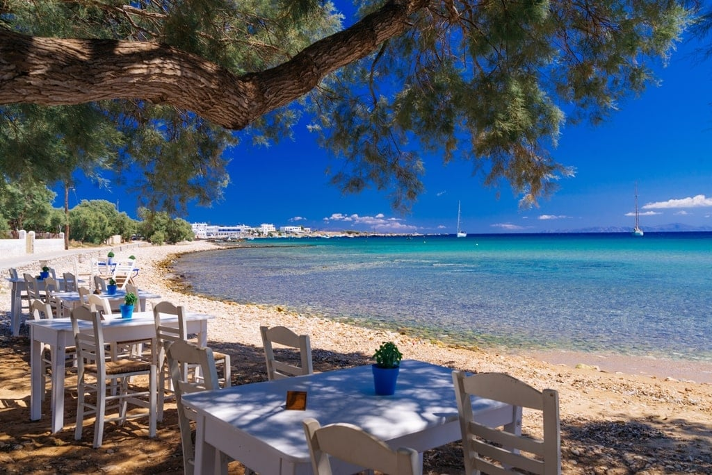 summer in Greece - a taverna by the sea on Paros island - What are the seasons in Greece